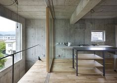 House in Yagi containing an indoor courtyard by Suppose Design Office # beton