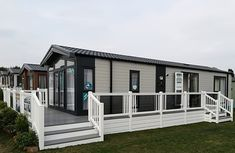 Fensys holiday home decking on Swift 2018 Champaigne Lodge Plastic Fencing, Decking Suppliers, Caravan Holiday, Led Manufacturers, Tiny House Plans, Mobile Homes, Caravans, Future House, Swift
