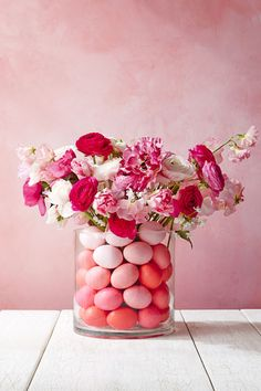 Even grocery store flowers look special with ombre Easter eggs and an easy vase hack.