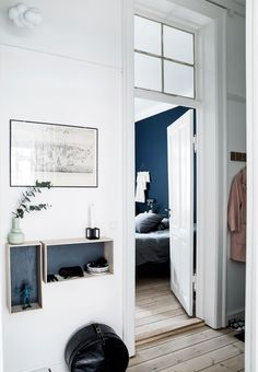 Small entryway with a practical coat rack and smart shelves for storage.