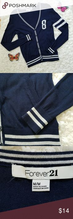 Navy Blue Button Down Letterman Style Cardigan This adorable cardigan has front pockets and great striped detail on sleeves and waist. Lightweight, size MEDIUM. In great condition. Forever 21 Sweaters Cardigans