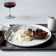 Milk-Braised Pork Chops with Mashed Potatoes and Gravy | Braising pork in milk, a method that Jimmy Bannos Jr., of The Purple Pig learned while cooking in Florence, results in supertender meat and an incredibly rich and flavorful gravy.