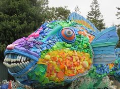 "6 Extraordinary Art Projects Use Plastic Trash to Highlight the Crisis Facing the World's Oceans . ""Priscilla the Parrot Fish"" by nonprofit Washed Ashore"