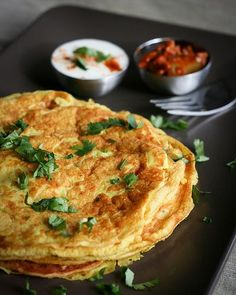 Besan Cheela - (a popular North Indian street food similar to pancakes. This recipe uses chickpea flour, water, fresh coriander, chilli and salt get mixed into a batter, then cooked as you would a run of the mill pancake in a hot nonstick pan. Indian Snacks, Indian Food Recipes, Vegetarian Recipes, Cooking Recipes, Snack Recipes, Chickpea Pancakes, Savory Pancakes, Chickpea Omelette, Indian Breakfast