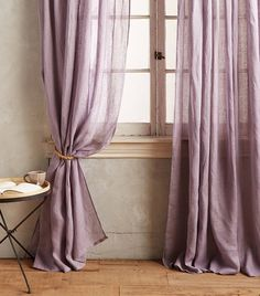 SImple rope tie back looks great with these linen curtains from Anthro  via @MyDomaine