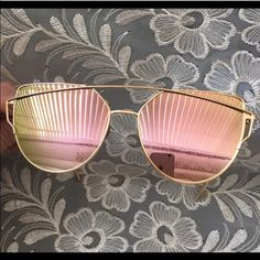 """HOST PICK Rose Sheen """"Cross Wire"""" Sunglasses Rose with green fade mirror lenses. Gold color frame. Approximately 5 3/4"""" across from outermost angle to outermost angle. Each lens measured vertically, 2"""". Wide and oversize appearance. Seller not responsible for fit nor comfort. Unbranded. Plastic frames and lenses. No case. Lens cloth and drawstring pouch included. Brand new retail w/o tag. I do not model sunglasses. No trades, no holding, no offsite payment.      PRICE IS FIRM UNLESS…"""