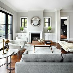 Love the blk window frame, the furniture layout, amount of seating, colors