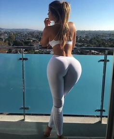 Blonde girl with pony tail in white bra & yoga trousers