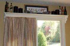 Shelf with curtain rod above sliding doors. Fabric is just draped right now... that's my next project :-)
