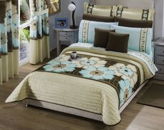 EDREDÓN RENATA.  Los estampados de flores potencializan la feminidad y dan cierto aire bohemio en la habitación. El azul turquesa hace el contraste perfecto para que tu cama sea el centro de atención.