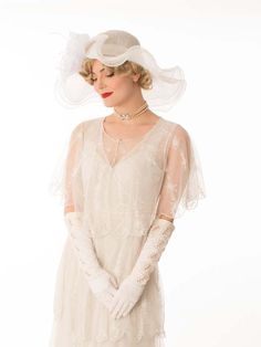 <p>For the bride who envisions a wedding with a romantic vintage flair! Ivory embroidered tiered Edwardian style tea gown with matching capelet is a perfect dress for a summer garden ceremony. Pair with Mary Jane pumps, ivory gloves, a pearl choker and wide brimmed hat decorated with flowers. <br /><br />DETAILS <br />•Ivory fine tulle netting with intricate embroidered designs over an ivory cotton slip liner. <br />•Sleevele...