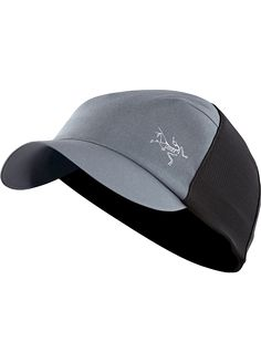 0c5621ce Escapa Cap A technical trucker hat made from breathable nylon fabric and  featuring a stretch mesh back.