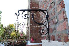 Hanging Basket Bracket, handmade ironwork by Tom Fell - Blacksmith by TomFellBlacksmith on Etsy https://www.etsy.com/listing/208073498/hanging-basket-bracket-handmade-ironwork