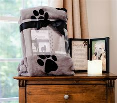 Pawprints Left by You, new pet memorial blanket is a warm way to expresses sympathies for the loss of a beloved dog or cat.