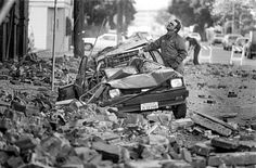 Loma Prieta earthquake caused bricks from buildings to fall on the street and cars in San Francisco. October 18, 1989 Photo: Steve Ringman, The Chronicle