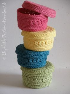 Colorful Crocheted Baskets. No pattern on the site, but I can search for that if I'm going to attempt it.