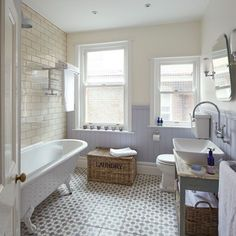 Shabby chic bathroom with period-style sanitaryware and lilac walls
