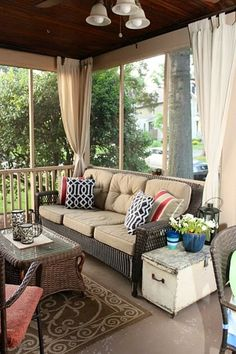 Curtains on the screened porch.