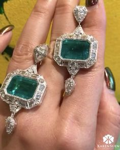(@karensuenfinejewellery) exquisite pair of earrings adorned with rare rectangular emeralds