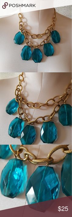 Vintage glass and gold necklace mint condition Vintage glass and gold necklace mint condition  Large blue glass pendants on a gold colored linked necklace. Vintage Jewelry Necklaces