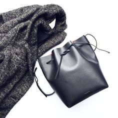 Mansur Gavriel Bucket Bag and Isabel Marant Coat. Flat lay - OVRSLO