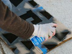 Apply Spray Paint - Make a Monogrammed Holiday Doormat on HGTV