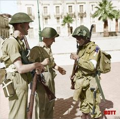 'Operation Husky' the Allied invasion of Sicily July 1943  British troops of the 6th Battalion, Durham Light Infantry, 151st Brigade chat with an American paratrooper of the 505th PIR in the Piazza Umberto I, Avola, Sicily. 11 July 1943.