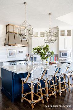 Kitchen Island featuring Morris Lantern. Kitchen with three Suzanne Kasler Morris Medium Lantern in Polished Nickel. Lighting Suzanne…