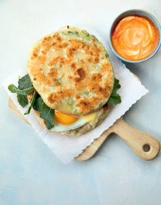 Mei Mei's Egg, Cheddar, and Greens Sandwich on Scallion Pancakes Recipe Spinach Recipes, Veggie Recipes, Asian Recipes, Vegetarian Recipes, Pancake Breakfast, Egg Recipes For Breakfast, Taiwanese Breakfast, Scallion Pancakes, Griddle Cakes