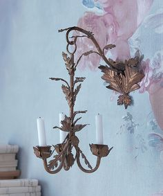 Delightful gilded and distressed Rococo style wall hanging candelabra.