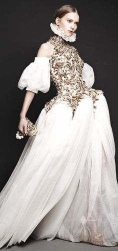 Alexander McQueen. I like this dress as it is contrasting in two different textures, the top half has a very ornate pattern whereas the bottom half is more flowing.