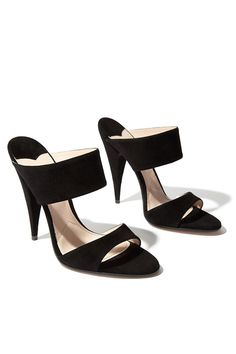 Miu Miu suede mules are an instant classic–sleek and stunning.