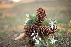 #diy organic wintery bouquet made with pine cones and branches, and baby's breath