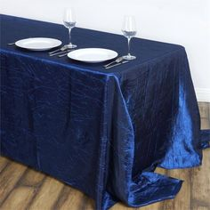 """Navy Blue 90x132"""" Crinkle Taffeta Tablecloths /  Let this exquisite tablecloth enchant the entire ambiance of your special event with its seamless luster and upscale look. Blending the modern flair with traditional sophistication, this magnum opus is simply magnificent. Spread it atop your dreary tables or plain, lackluster table covers to achieve the excellence of class and vibrancy. The lovely crinkles accented all over the surface coupled with the impeccable metallic glint of lustrous…"""