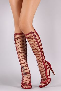 This chic heel features a strappy knotted detail with snake print vegan leather trim, crisscrossing elasticized straps at front shaft, and wrapped stiletto heel. Finished with a lightly padded insole