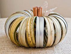 Awesome pumpkin made of mason jar rings!