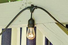 Hang string lights on outside railing of deck Porch String Lights, Hanging Patio Lights, Vintage String Lights, How To Hang Patio Lights, Metal Pergola, Deck With Pergola, Pergola Ideas, Pergola Plans, Pergola Kits