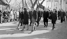 11/25/63: Jacqueline Kennedy leads the funeral procession out of the White House grounds, headed to St. Matthew's Cathedral.