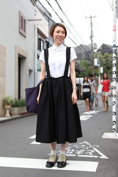 14 Trendsetting Street-Style Snaps From Tokyo #refinery29  http://www.refinery29.com/34605#slide8  Where can we get our own suspender skirt? Office Worker Rei's stark style is superb.