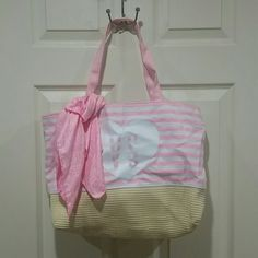 Victoria's Secret Tote Bag Good used condition VS secret tote bag with scarf. Used but still in great shape! No rips. The handles a little dirty and there's some dirt on the back side. Nothing a little cleaning can't fix.   Dog household. Non-smoking household. Victoria's Secret Bags Totes