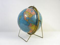 World Globe.  Gotta have one....  I found one just like this at an antique mall for $22.  I already have a globe but.....