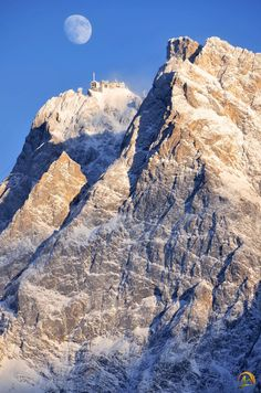 Zugspitze..highest peak in Germany. Had lunch with my mom while there..it was July and people were skiing in their bikinis. lol!