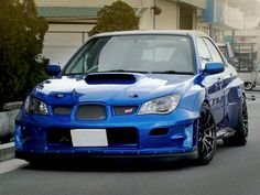 Nice Scooby... aka Subaru Impreza (modded STI shown). Just some awesome craftmanship in this clean build. If you ever get a chance, rent an STi or WRX for a fun day of curvy road driving and ear 2 ear grins.