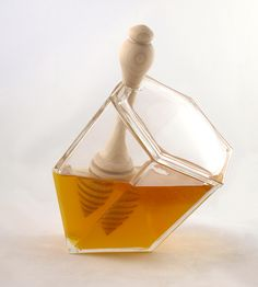 Appropriately shaped honeycomb cell Honey Set made with recycled glass. Dipper is made of maple.