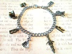 ONCE UPON A TIME *RUMBELLE* Bracelet w/ Eight Charms by PhoenixEchoCreations, $21.00 #Etsy #PhoenixEchoCreations #OUAT #Rumbelle #OnceUponATime