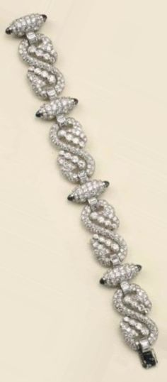 An Art Deco platinum, diamond and sapphire bracelet, circa 1935. With French import marks.