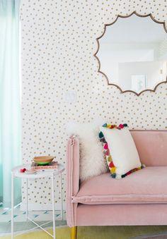 pink velvet sofa + polka dot wallpaper