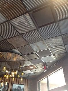 Reclaimed Rustic Metal Roofing used for ceiling tiles. This would be great for a rustic bakery/ restaurant.
