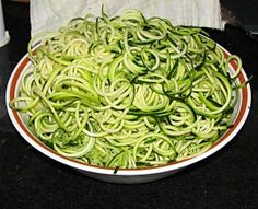 uncooked zucchini noodles in bowl