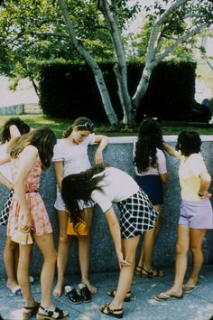 Teenage girls in summer clothes standing by a wall, c.1972, Tony Ray-Jones
